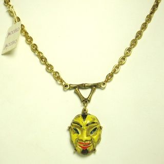 Coro enameled yellow asian man